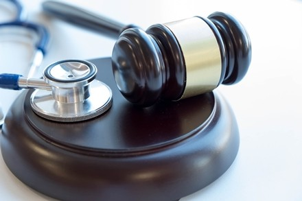 gavel near stethoscope representing alliance between black point funding and medical lein claims
